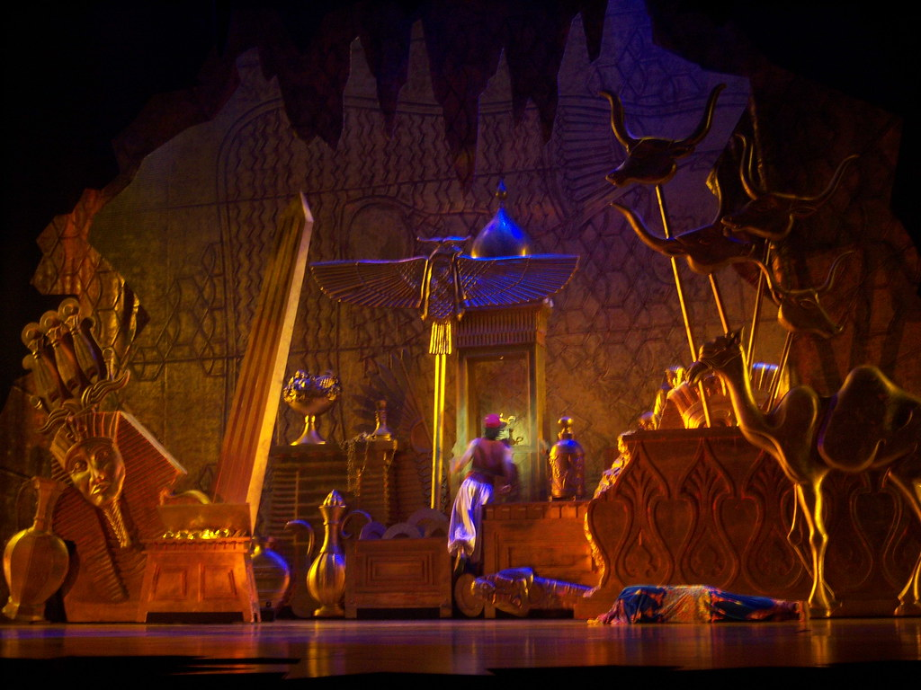 Aladdin spies the genies lamp in the Cave of Wonders in A