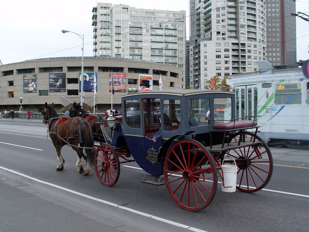 Melbourne's land transport: horse-carriage and tram ride ...