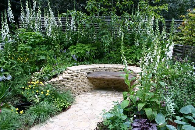 stone bench in garden this garden design image is in copyr flickr. Black Bedroom Furniture Sets. Home Design Ideas