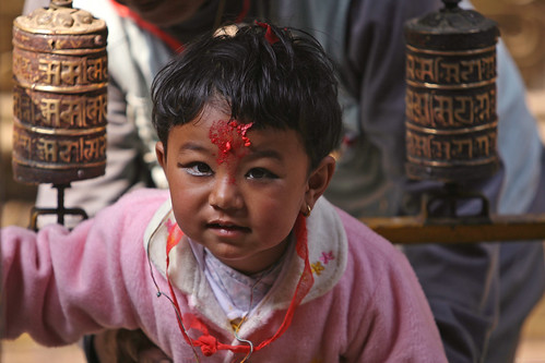 Young girl at Buddhist temple | by World Bank Photo Collection
