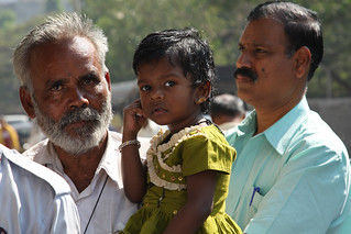 Little girl in her father's arms | by World Bank Photo Collection