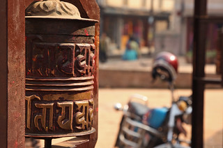 A prayer wheel in a temple | by World Bank Photo Collection