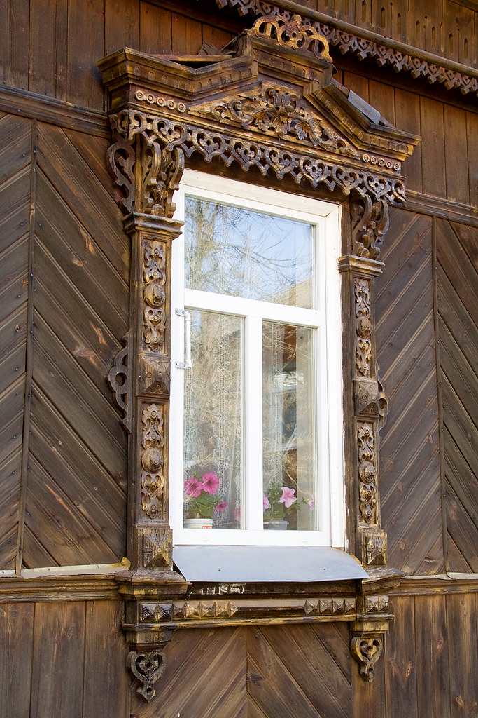 Carved window decorations wooden fretwork is a common styl. .