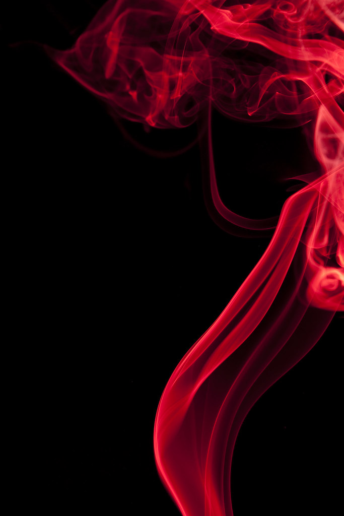 red smoke smoke on black background jordan mccullough