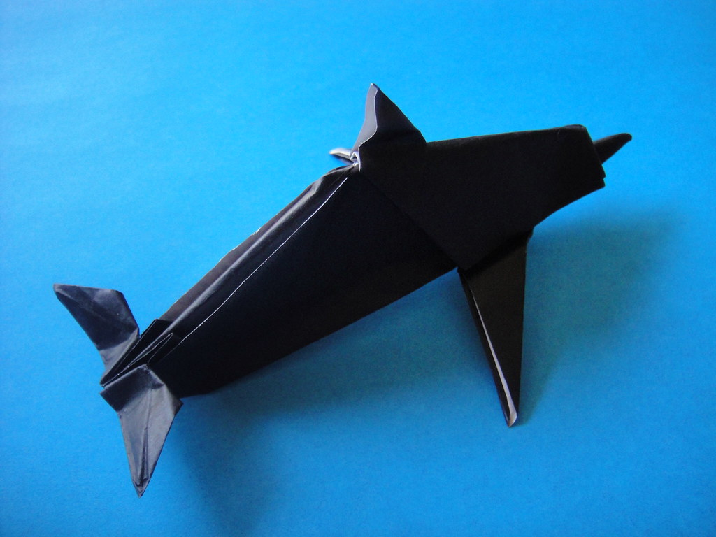 dolphin design by john montroll folded from a 9 inch