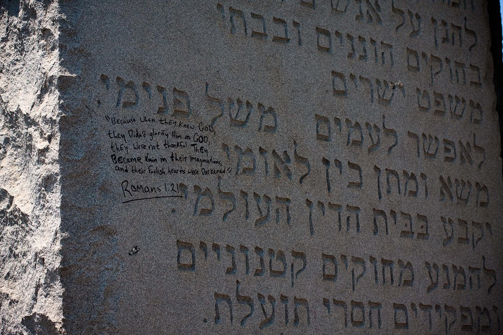 georgia guidestones graffiti written on the georgia
