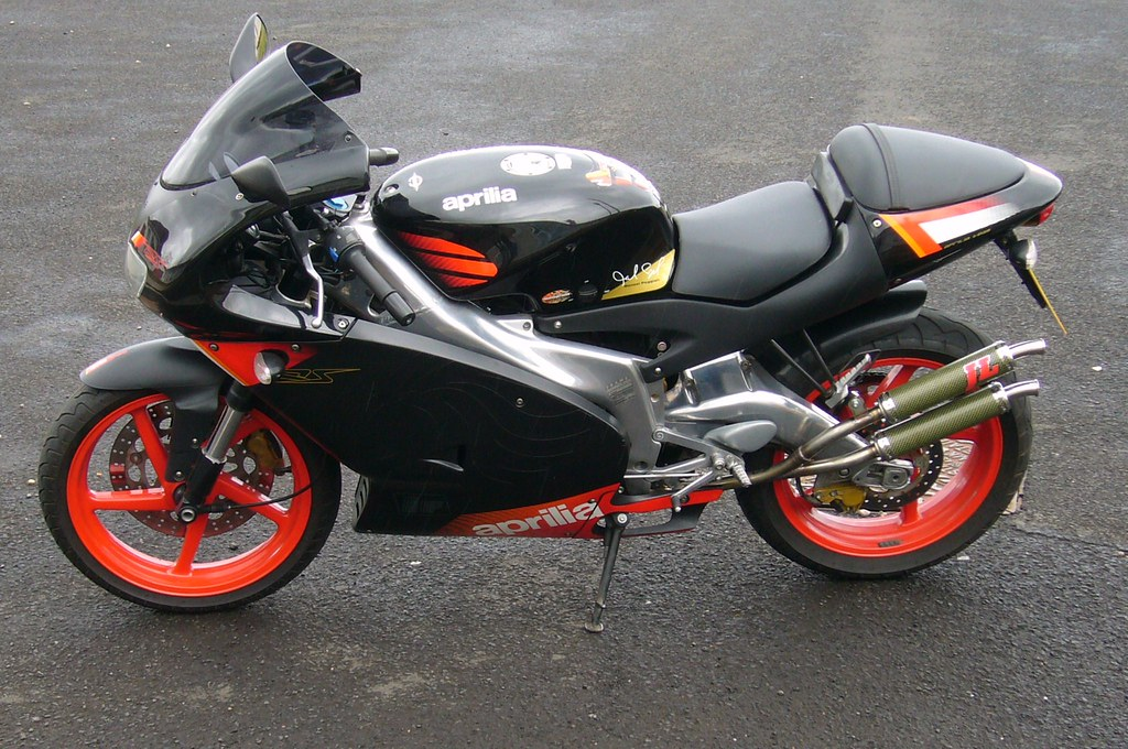 2004 aprilia rs 125 my son 39 s rs125 with new stainless. Black Bedroom Furniture Sets. Home Design Ideas