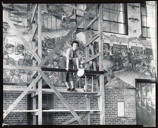 Aline H. Rhonie, American painter, 1909-1963, at work on aviation mural at Roosevelt Field, Garden City, New York | by Smithsonian Institution