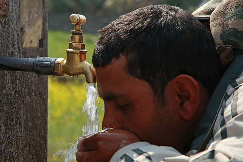 Man drinks water from tap in Kaski, Nepal | by World Bank Photo Collection