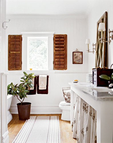 Classic white bathroom with tropical decor: Red oak floors +