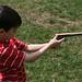 Boy with [just a toy wooden] gun