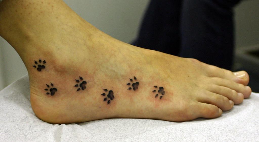 Paw Print Tattoo On Bottom Of Foot: Paw Prints On Foot Tattoo