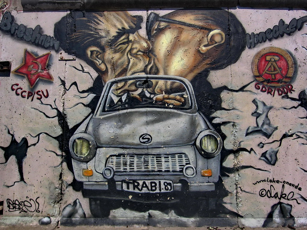 Berlin wall art trabant famous brezhnev honecker kiss for Berlin wall mural