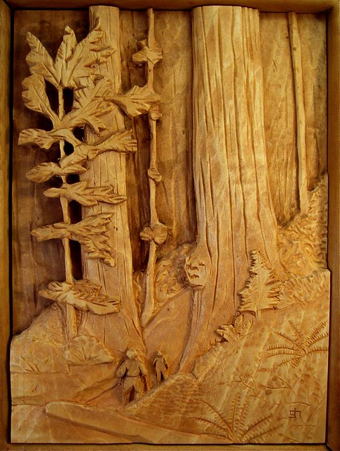 Redwood scene the relief carving of hikers hiking