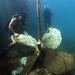 Navy Diver 2nd Class Justin McMillen maneuvers a sunken ship's screw.