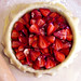 strawberries just placed in dough
