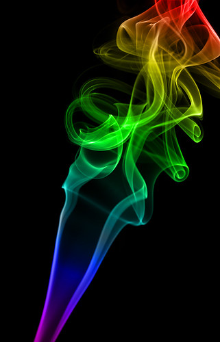 Abstract rainbow color smoke on black background | Flickr ...