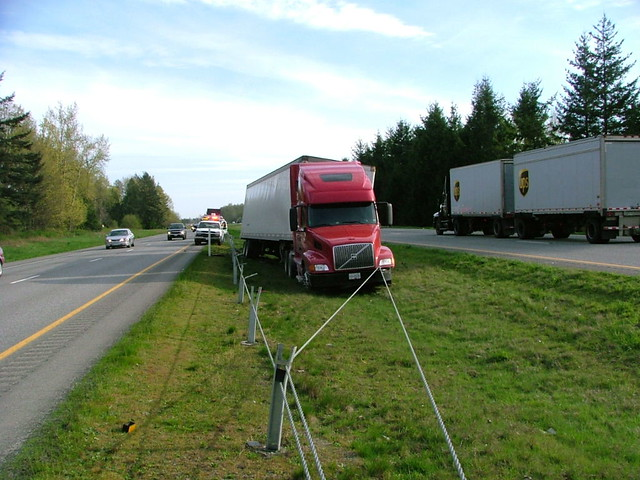 Semi stopped by cable barrier the median