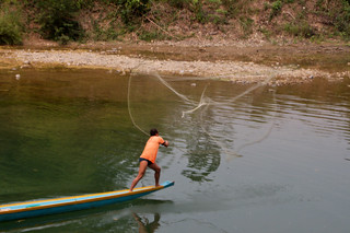 Fisherman in Vang Vieng | by Christian Haugen