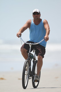 Beach cyclist taken with 500mm | by Cameralabs