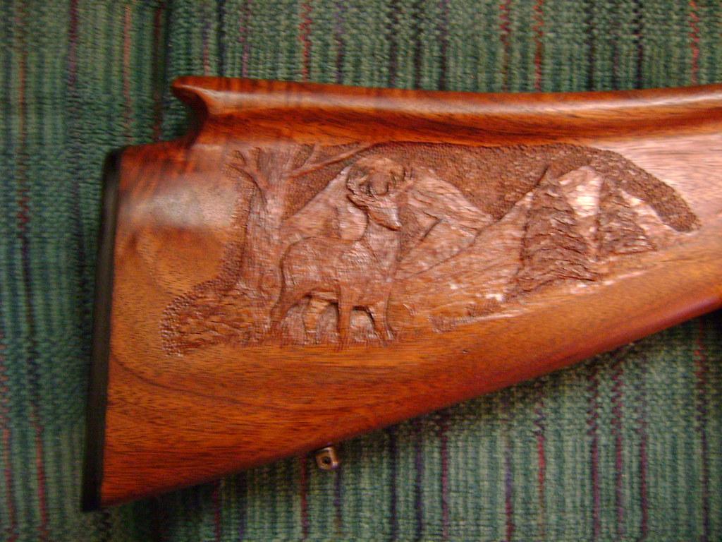 Reverse of cheek rest deer scenery relief carved on