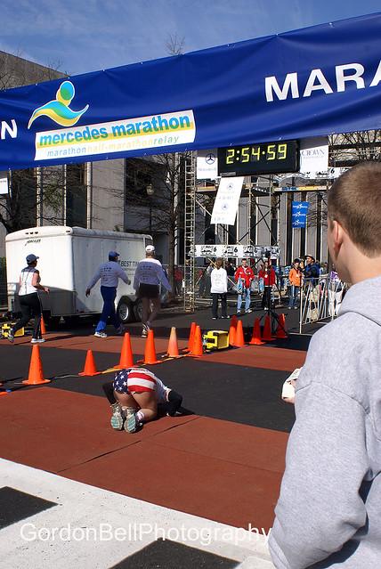 Mercedes full marathon female winner kissing the ground at for Mercedes benz marathon birmingham