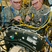 Air Force Fellows Clint Abell and Jeff Gillen work on Smarter Diesel Engine (SDE) 21