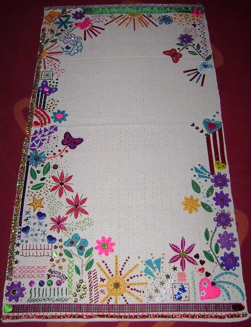 Hand embroidery onto mat using felt
