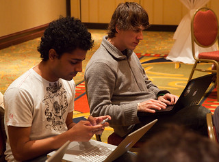 SxSW- Working on yer startup during panels. Naveen Selvadurai & Dennis Crowley of foursquare | by finitor