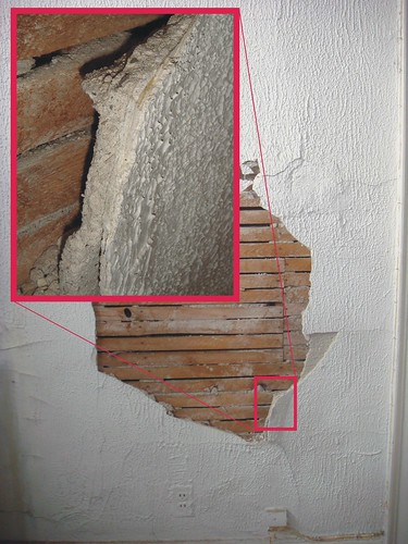 Asbestos plaster layers example of an old asbestos for Is there asbestos in old drywall
