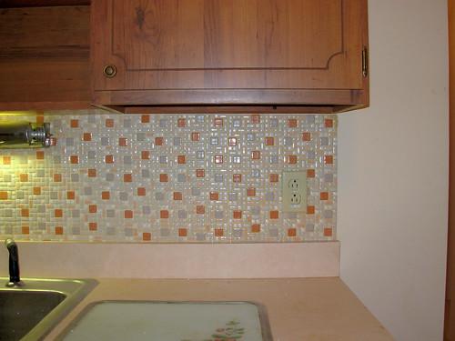 tiled backsplash upper cab and laminate counter