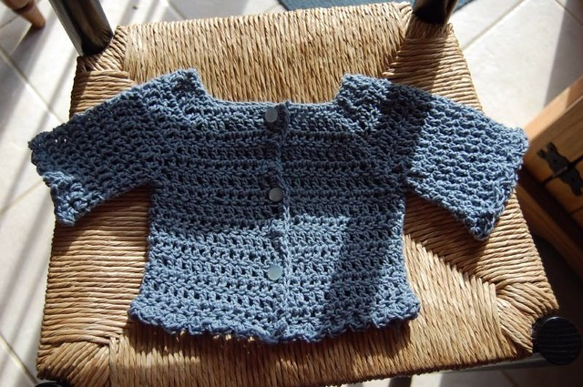 crochet baby sweater I finally got around to sewing on the? Flickr