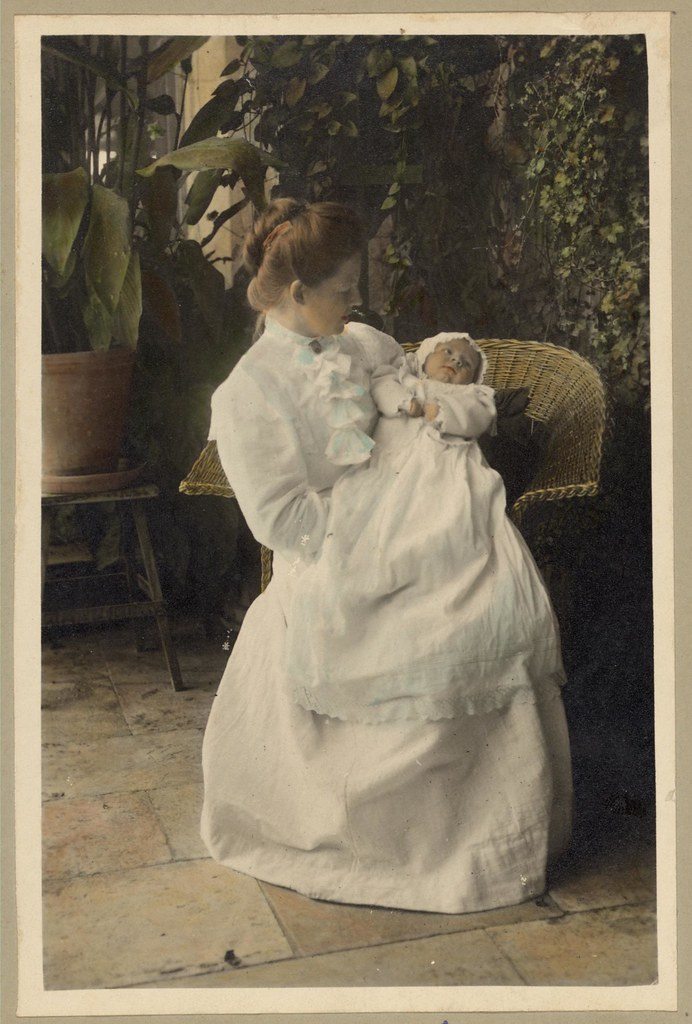 Vintage Portrait Of A Mother Holding A Baby Child On The P