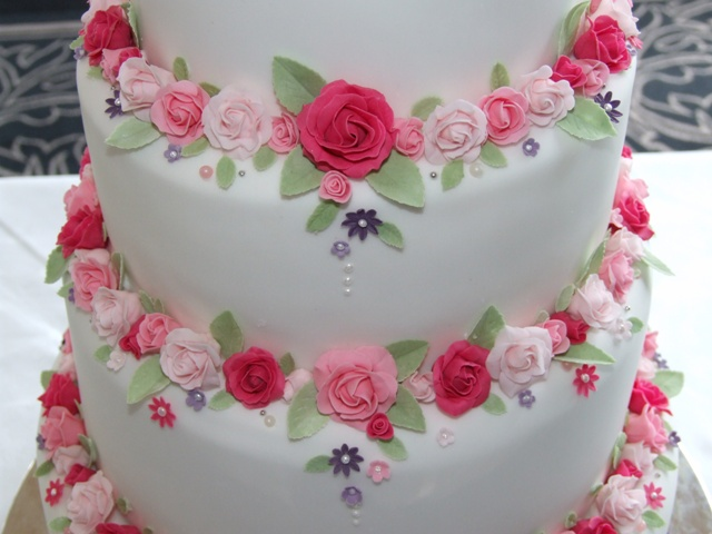 wedding cake with roses between tiers pink wedding cake between tiers up of 26960