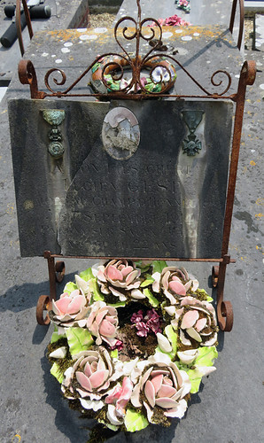 A wreath of ceramic roses mark a tomb in the cemetery in the Medieval Village section of St-Valery-sur-Sommes