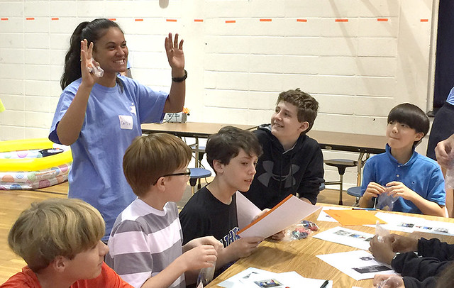 Auburn accounting student helps students at Drake Middle School learn basic finance lessons through games and activities.