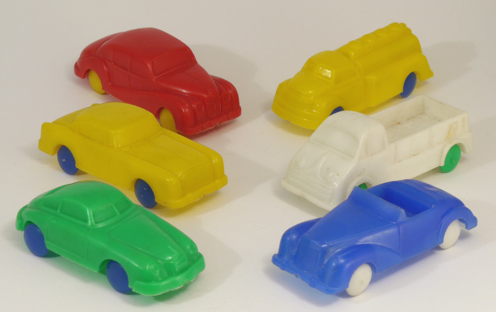Six Plastic Toys Six Small Plastic Toy Cars In A Soft