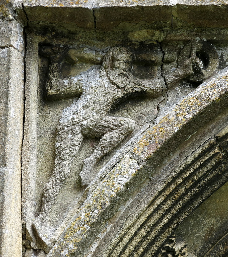 Wild Man (also Wildman, Woodwose, Wodewose), spandrel of the west doorway (mid-15th C.), the Church of St Mary, Cratfield, Suffolk, England