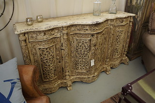 Wood-carved piece of furniture