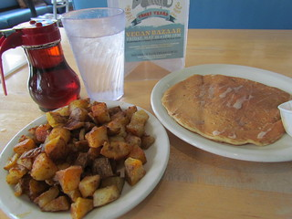 Orange Cranberry Pancake and Home Fries from Kerbey Lane Cafe
