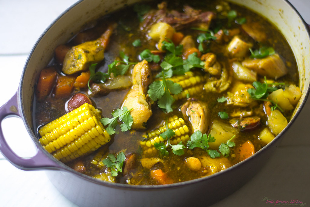 Sancocho Dominicano is a hearty stew full of three meats, corn, yucca and sweet potato.