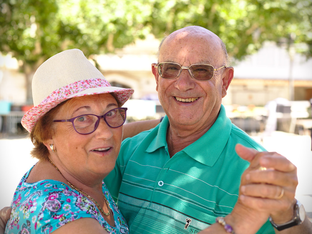 Dancing Elderly Couple While On Holiday In Rosas Spain