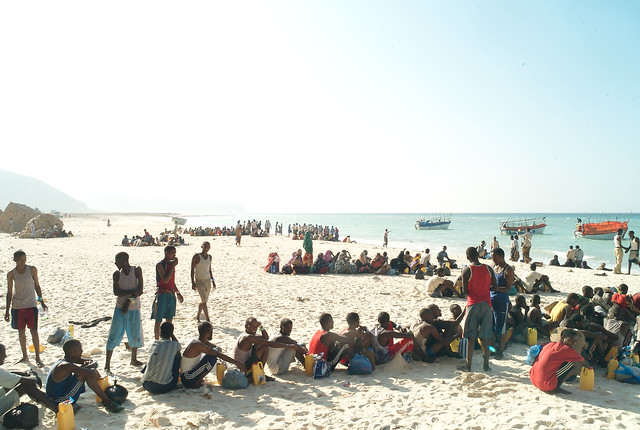 Men, women and children line up on a Somalia beach to board the boats that will take them across the Gulf of Aden to Yemen.