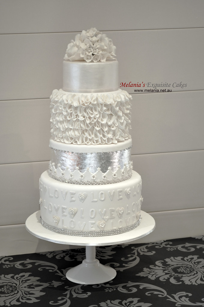 White Wedding Cake With Silver Leaf Lustre Ruffle And Su
