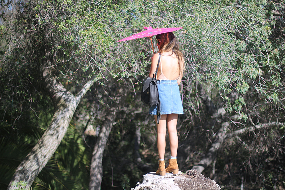 Nasty Gal Alina bodysuit in blush, Zara denim button-up skirt, ZooShoo boots, parasol, vintage Coach backpack
