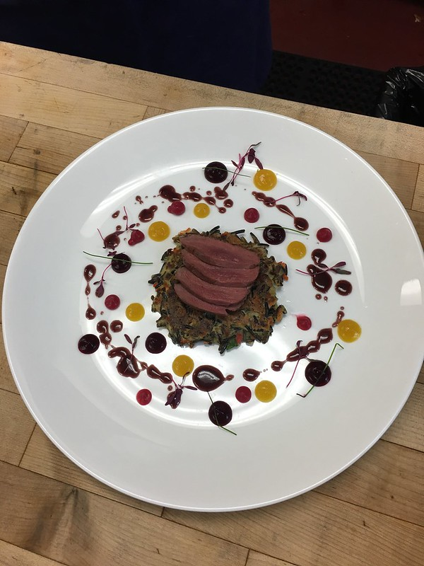 Duck with wild rice pancake and beet puree