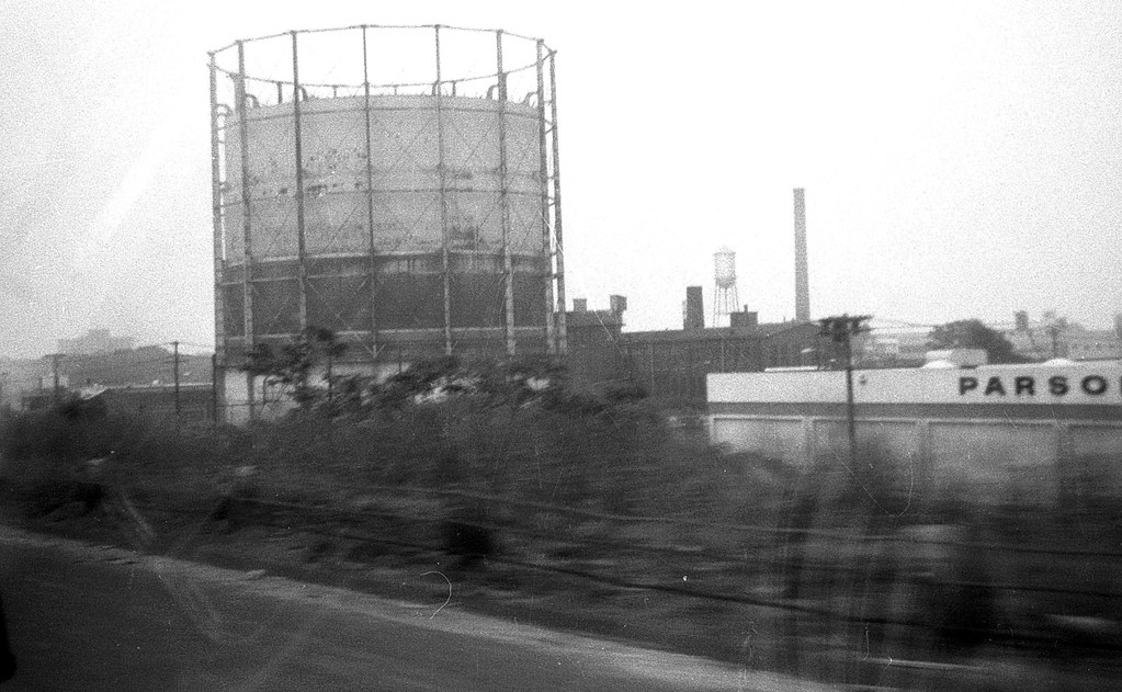 A rusting industrial gas tank, (a gasometer, as they're ca ...