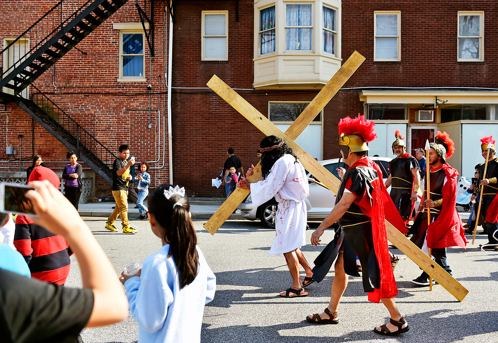 © 2016 by The York Daily Record/Sunday News. Carrying a cross of 2x4 planks, Jesús Solorio performs as Jesus Christ as he and others walk down East South Street during a Good Friday street procession held by the Immaculate Conception of the Blessed Virgin Mary Church Friday, March 25, 2016, in York.
