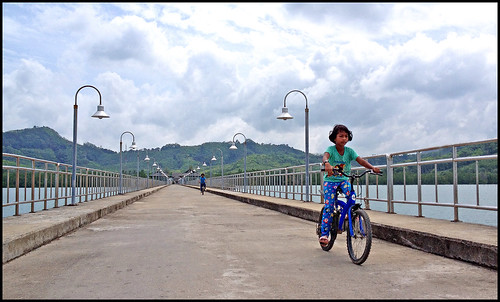 Girls riding bikes on Khlong Kian Pier