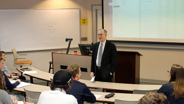 Auburn Professor James Barth talks with students in a classroom.